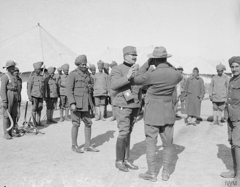 A Serbian Colonel showing an Indian Offcer how to use a Camera. Salonika, March 1917. © IWM Q 32816