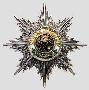 "Der ""Hohe Orden vom Schwarzen Adler"", gestiftet Preußen 1701, Q https://commons.wikimedia.org/wiki/File:Black_Eagle_Order_star.jpguelle: Wikimedia Commons, gemeinfrei"